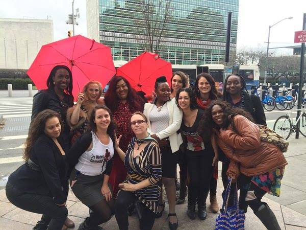 Activists and supporters of sex work and sex workers movement pose for the camera in NYC.